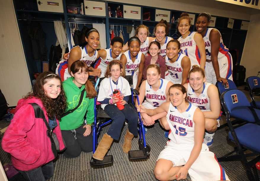 Kayla Wenger and the American women's basketball team bonded through the Friends of Jaclyn Foundation, an organization that matches children with brain tumors with college athletic teams. Kayla was the Eagles' ultimate good-luck charm; they never lost when she was at their games. (Photo provided by AUEagles.com)