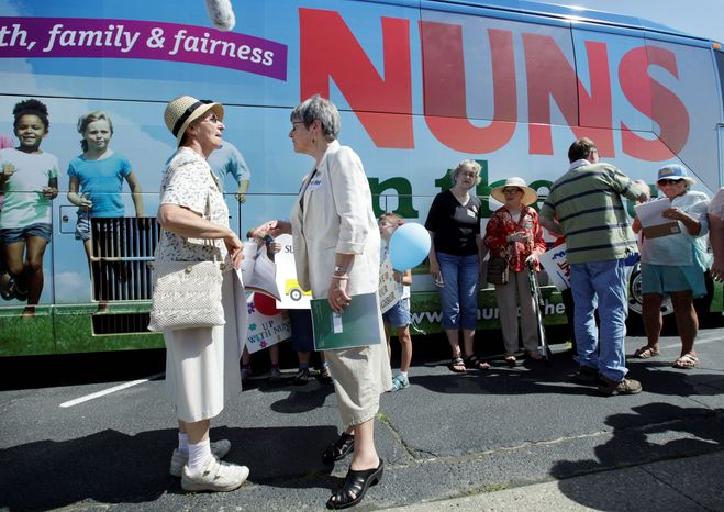 Sister Simone Campbell (right), executive director of Network, talks with Sister Lorraine Schmaltz of Ames, Iowa, on Monday, the first day of a nine-state tour protesting proposed federal budget cuts. (Associated Press)