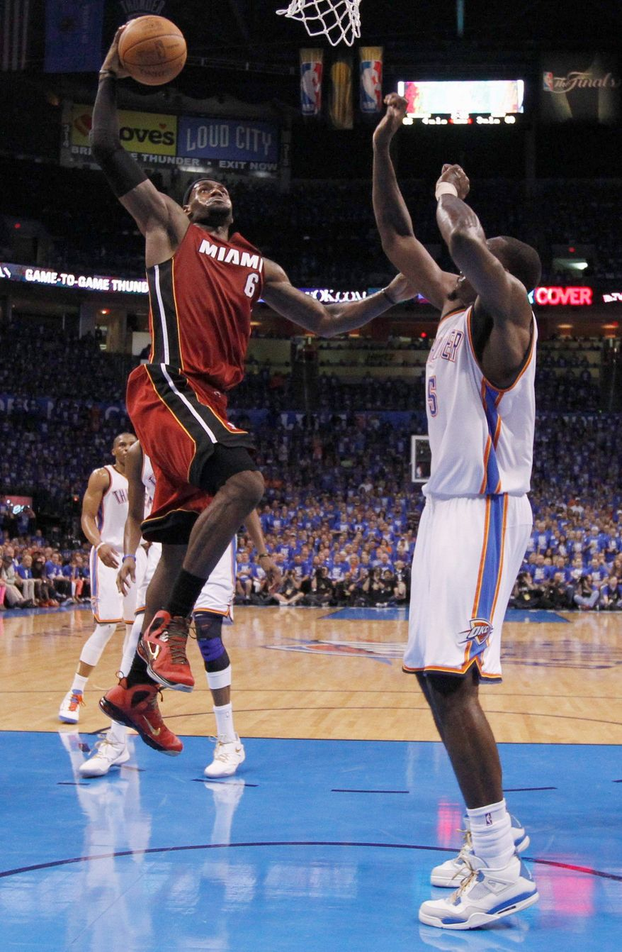 Miami Heat small forward LeBron James shoots against Oklahoma City Thunder center Kendrick Perkins (5) during the second half at Game 1 of the NBA finals basketball series, Tuesday, June 12, 2012, in Oklahoma City. (AP Photo/Jim Young, Pool)