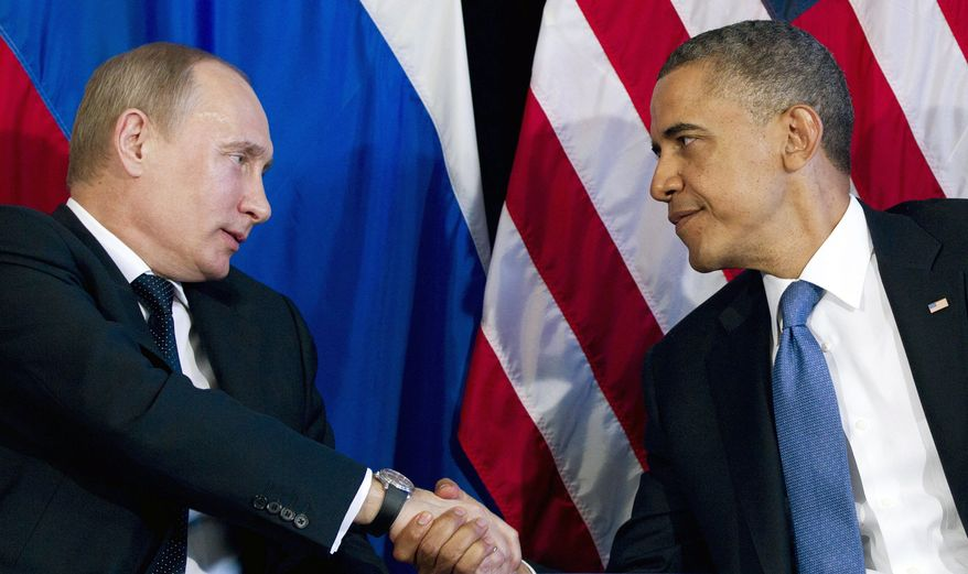 ** FILE ** President Obama meets with Russian President Vladimir Putin  at the G-20 summit in Los Cabos, Mexico. (Associated Press)