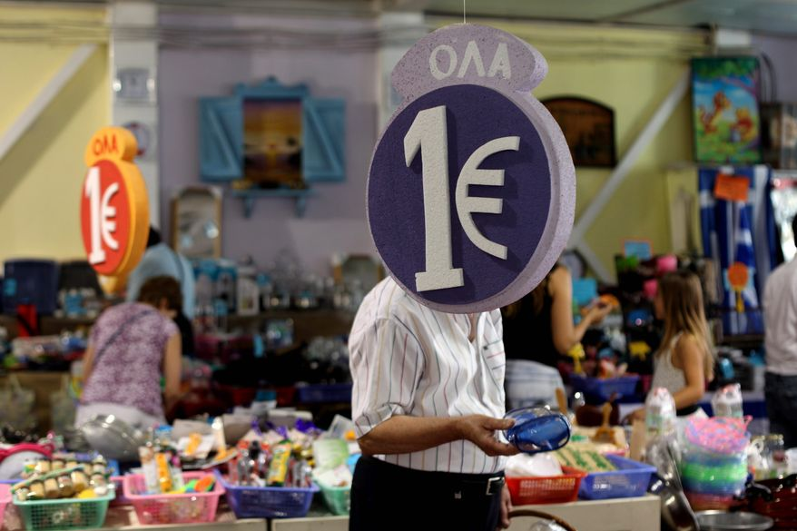 """Customers browse discounted goods for sale at a """"1 euro store"""" Monday in Athens. Greeks voted Sunday for parties supporting the nation's bailout package, which Mr. Obama, at the G-20 summit, said """"indicates a positive prospect."""" (Associated Press)"""