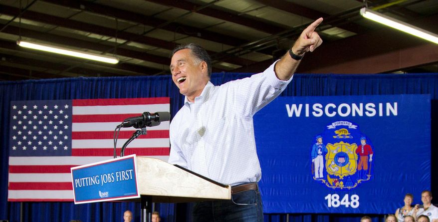 On a bus tour of Wisconsin that included a stop Monday at Montery Mills in Janesville, Mitt Romney had a carefully modulated response to President Obama's surprise decision on illegal immigrants. (Associated Press)