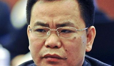 **FILE** Businessman Lin Chunping attends a March 13, 2012, press conference in Wenzhou, in eastern China's Zhejiang province. (Associated Press)