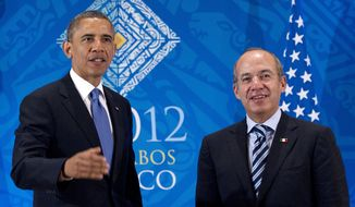 ** FILE ** President Obama attends a bilateral meeting June 18, 2012, with then-Mexican President Felipe Calderon during the G-20 Summit in Los Cabos, Mexico. (Associated Press)