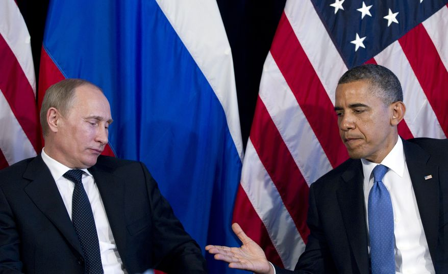 President Obama holds out his hand to shake Russian President Vladimir Putin's during a bilateral meeting at the G-20 summit on Monday, June 18, 2012, in Los Cabos, Mexico. (Associated Press)