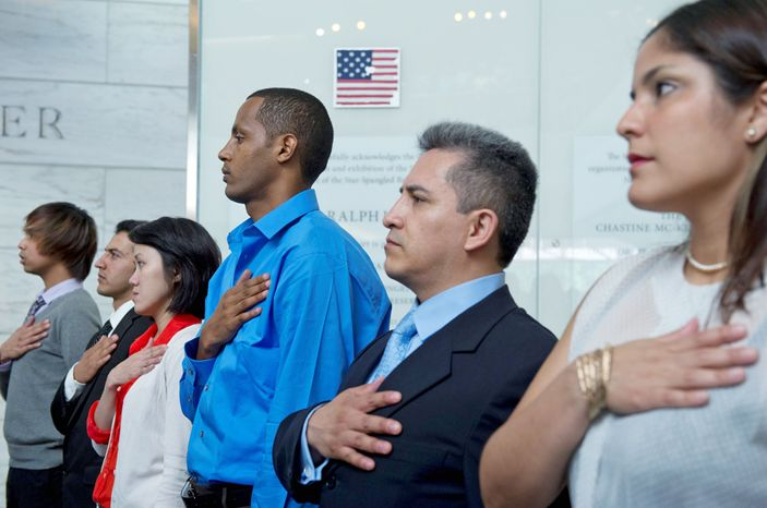Immigrants take part in a naturalization ceremony at the Museum of American History in the District last month. For the first time, the influx of Asians moving to the U.S. has sur