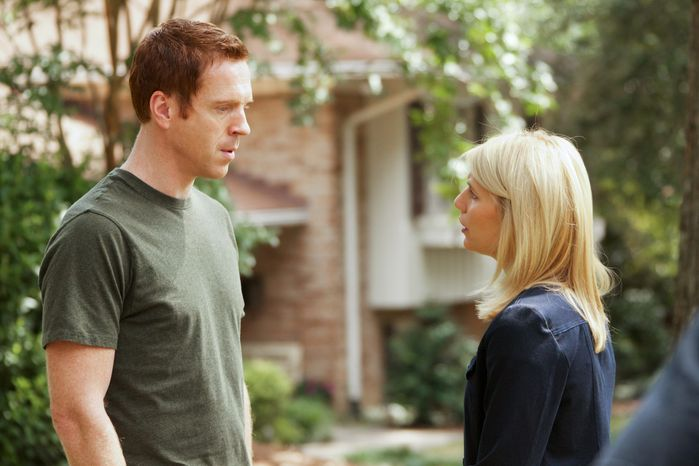 "In this image released by Showtime, Damian Lewis portrays Nicholas ""Nick"" Brody, left, and Claire Danes portrays Carrie Mathison in a scene from the Showtime original series, "" Homeland."" The show was nominated Thursday, Dec. 15, 2011 for a Golden Globe award for best TV drama series. Lewis and Danes were also nominated for best actor and actress in a TV drama series. (AP Photo/Showtime, Kent Smith)"