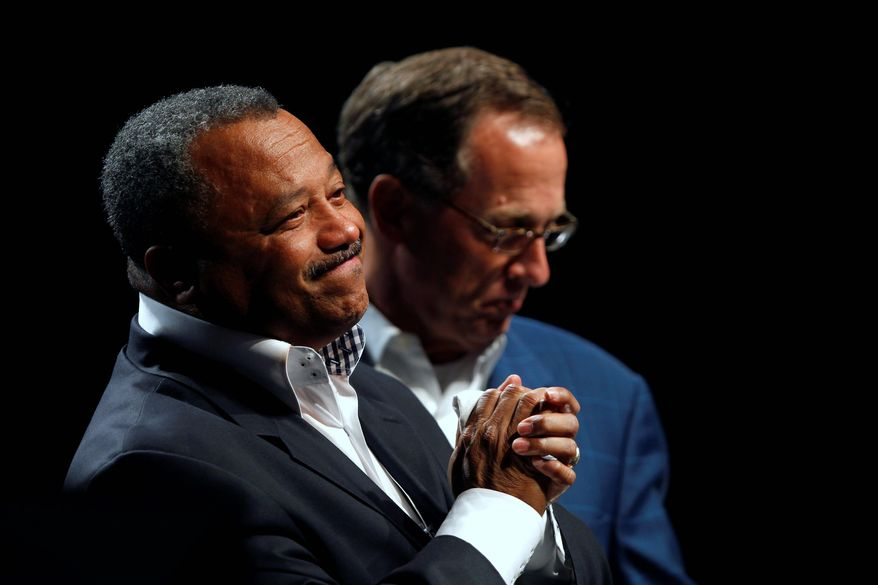 The Rev. Fred Luter smiles at the warm welcome from the Southern Baptist Convention in his hometown of New Orleans after his election Tuesday as its first black president. With him is on stage is outgoing President Bryant Wright. (Associated Press)