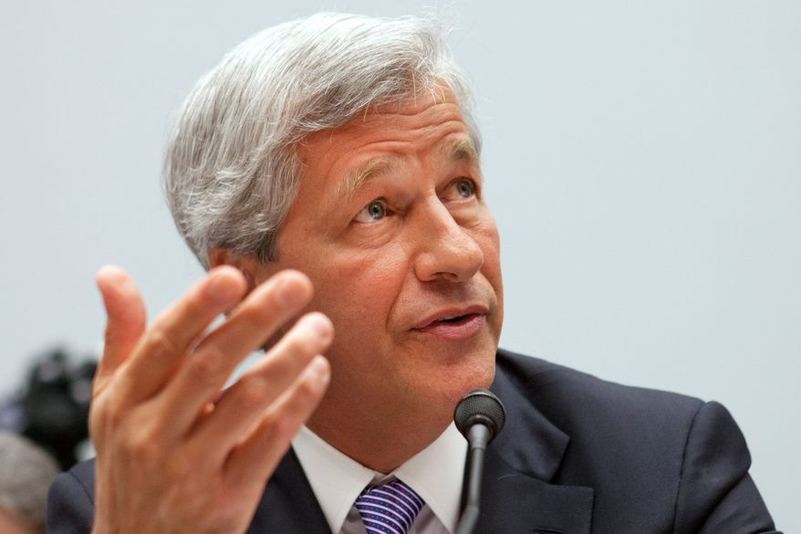 Back on Capitol Hill to discuss JPMorgan Chase & Co.'s $2 billion trading loss this spring, CEO Jamie Dimon firmly denied Tuesday that the total could soar. (Associated Press)