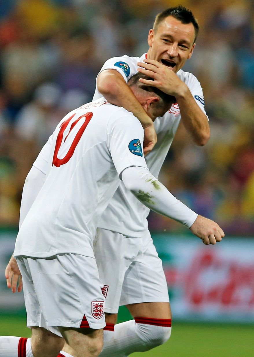 associated press Wayne Rooney (left)and John Terry celebrate after Rooney scored England's only goal in a win over Ukraine.