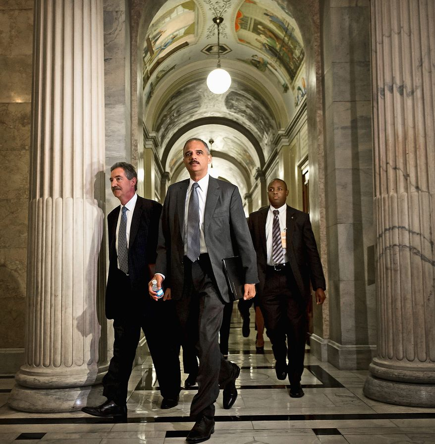 U.S. Attorney General Eric H. Holder Jr. arrives on Tuesday with Deputy Attorney General James Cole (left) at the U.S. Capitol to meet with House members seeking documents on the Fast and Furious gurnrunning investigation. (Andrew Harnik/The Washington Times)