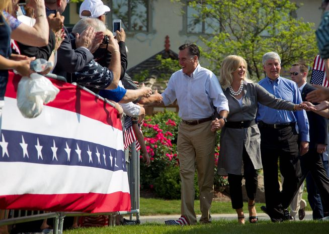 """Presumptive GOP presidential nominee Mitt Romney campaigns in Frankenmuth, Mich., on Tuesday alongside his wife, Ann, and Michigan Gov. Rick Snyder. Mr. Romney's campaign called his six-state bus swing the """"Every Town Counts"""" tour. (Associated Press)"""