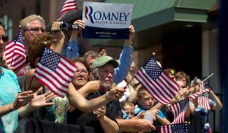 Romney supporters rally in DeWitt, Mich., on Tuesday. Even among the crowds that turned out to hear Mr. Romney, it was evident that this fall's election will be a referendum on President Obama's first term. (Associated Press)