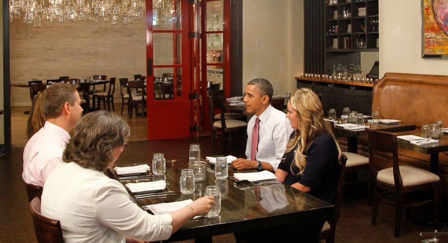 """President Obama eats lunch with winners of """"Lunch with Barack,"""" at the Lincoln Restaurant in Washington last week. Rewards for loyalty to a campaign can be as simple as a T-shirt or as special as preferential seating at a rally. """"I would call this the swag factor,"""" said Chas Mastin, who worked on a way to track supporter activity. (Associated Press)"""