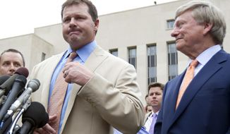 Former Major League Baseball pitcher Roger Clemens speaks to the media outside federal court in Washington on Monday, June 18, 2012, with his attorney Rusty Hardin at his side, after Clemens was acquitted on all charges by a jury that decided that he didn't lie to Congress when he denied using performance-enhancing drugs. (AP Photo/Manuel Balce Ceneta)