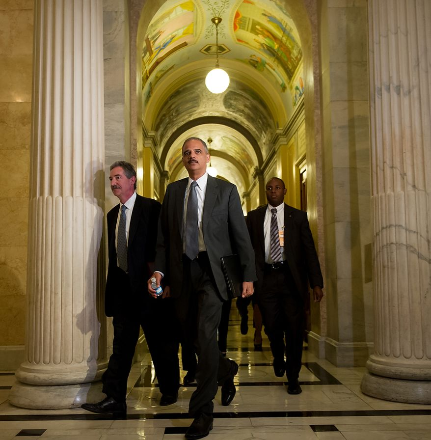 Attorney General Eric H. Holder Jr. arrives with Deputy Attorney General James Cole (left) at the U.S. Capitol in Washington on Tuesday, June 19, 2012, to meet with the House leadership to discuss the congressional investigation into the botched anti-gunrunning Fast and Furious operation. (Andrew Harnik/The Washington Times)