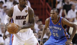 Miami Heat small forward LeBron James is defended by Oklahoma City Thunder small forward Kevin Durant during the second half of Game 4 of the NBA finals Tuesday, June 19, 2012, in Miami. (AP Photo/Lynne Sladky)