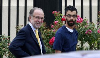 Dharun Ravi (right), 20, walks out of Middlesex County jail on June 19, 2012,with his attorney Steven Altman in North Brunswick, N.J. Ravi, the former Rutgers University student who was convicted of bias intimidation for using a webcam to see his roommate kissing another man, was released from jail after serving 20 days of a 30-day sentence. (Associated Press)