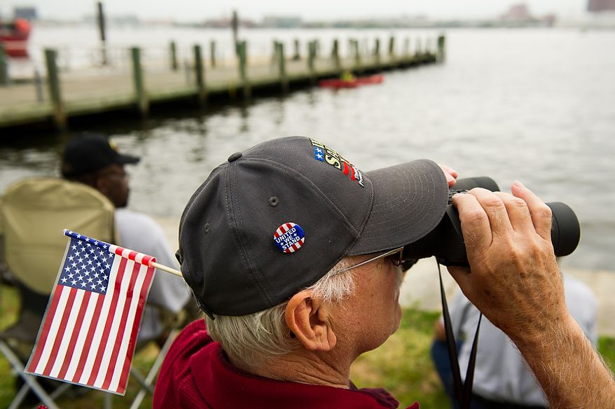 Ron Brill of Boiling Springs, Pa., uses his binoculars on the banks of Fort McHenry to keep an eye out for tall ships make their out of Baltimore Harbor after celebrating the Bicentennial of the War of 1812 and the writing of the Star-Spangled Banner as part of a week long international tall ship and naval vessel parade called the Star-Spangled Sailabration, Baltimore, Md., Tuesday, June 19, 2012. (Andrew Harnik/The Washington Times)