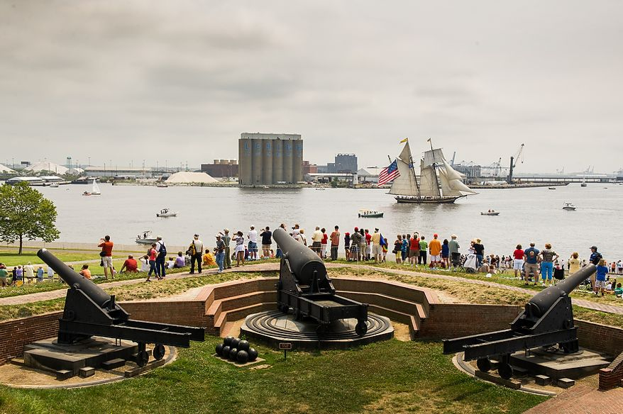 Visitors to Fort McHenry watch as the Pride of Baltimore II leads tall ships out of Baltimore Harbor after celebrating the Bicentennial of the War of 1812 and the writing of the Star-Spangled Banner as part of a week long international tall ship and naval vessel parade called the Star-Spangled Sailabration, Baltimore, Md., Tuesday, June 19, 2012. (Andrew Harnik/The Washington Times)
