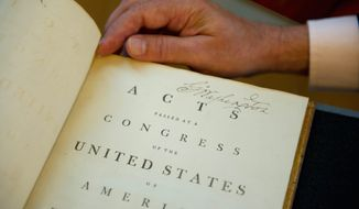 """The title page has a wonderful, large, bold signature. I've seen enough of Washington's writing over the years to almost immediately tell whether one is real or not,"" said Chris Cooper, who was charged with authenticating the book. (Barbara L. Salisbury/The Washington Times)"