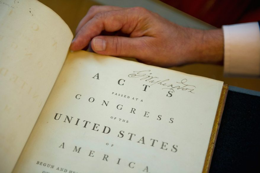 """""""The title page has a wonderful, large, bold signature. I've seen enough of Washington's writing over the years to almost immediately tell whether one is real or not,"""" said Chris Cooper, who was charged with authenticating the book. (Barbara L. Salisbury/The Washington Times)"""