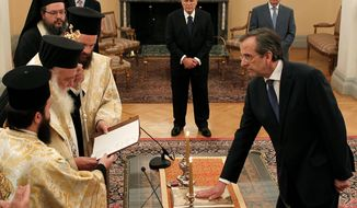 Antonis Samaras (right) is sworn in as Greece's prime minister during a ceremony at the Presidential Palace in Athens on Wednesday as Greek President Karolos Papoulias (background, center) looks on. Mr. Samaras heads a three-party coalition committed to upholding the country's international bailout commitments. (Associated Press)
