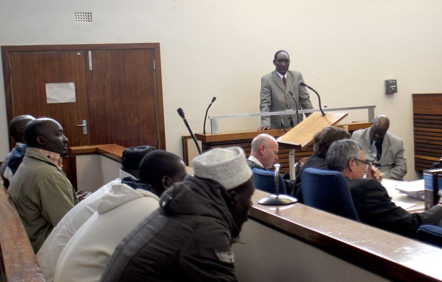 Gen. Faustin Kayumba Nyamwasa, who fled Rwanda after a falling out with the country's president, makes his first public appearance since he was wounded in Johannesburg in 2010 at the trial of the six men charged in the shooting. (Associated Press)