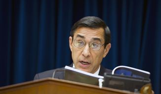"** FILE ** Rep. Darrell E. Issa, California Republican and chairman of the House Committee on Oversight and Government Reform, reads from a book on June 20, 2012, at the Rayburn House Office Building on Capitol Hill, quoting the president's right to assert executive privilege after learning that President Obama has done so in the ""Fast and Furious"" gun-tracking case, refusing to turn over related documents to Congress. The committee proceeded with its markup to vote on whether to hold Attorney General Eric H. Holder Jr. in contempt for his failure to produce those documents. (Barbara L. Salisbury/The Washington Times)"
