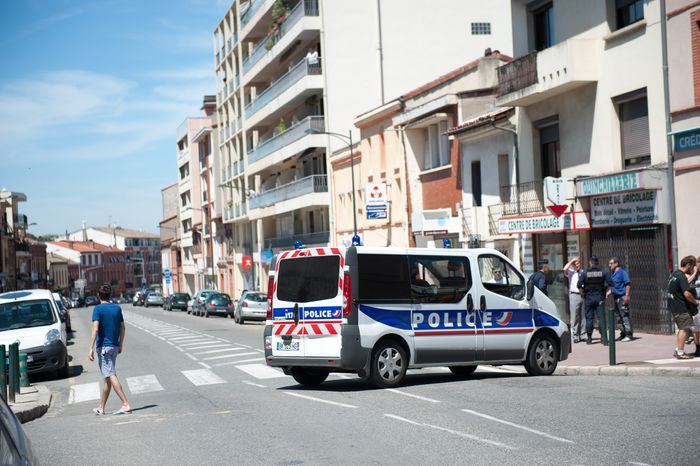 Police secure a street in Toulouse, France, near where a man took hostages in a bank and fired a shot, police said on Wednesday, June 20, 2012. French television reported the man had claimed allegiance to the al Qaeda terrorist group. (AP Photo/Bruno Martin)