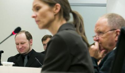**FILE** Psychiatric experts Synne Soerheim (center) and Torgeir Husby (right) are questioned June 16, 2012, in an Oslo court by judges and lawyers during the trial of Anders Behring Breivik (left), the self-confessed killer of 77 people in Norway in 2011. (Associated Press/NTB scanpix)