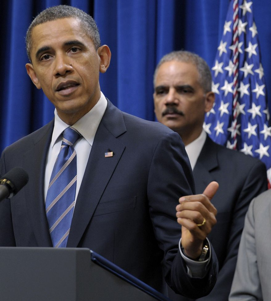 **FILE** President Obama (left) speaks Feb. 9, 2012, in Washington about a settlement with the nation's five largest banks over foreclosures. Attorney General Eric H. Holder Jr. is in the background. (Associated Press)