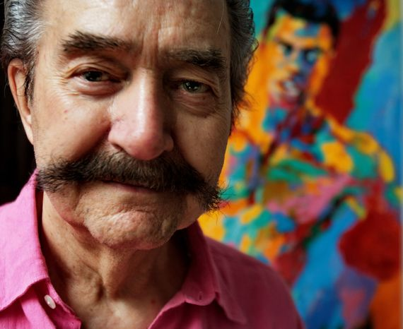 ** FILE ** In this Aug. 31, 2007 photo, artist LeRoy Neiman poses in his studio in New York. Neiman, who is best known for his colorful and energetic paintings of sporting events, died Wednesday, June 20, 2012 in New York. He was 91. (AP Photo/Bebeto Matthews, File)