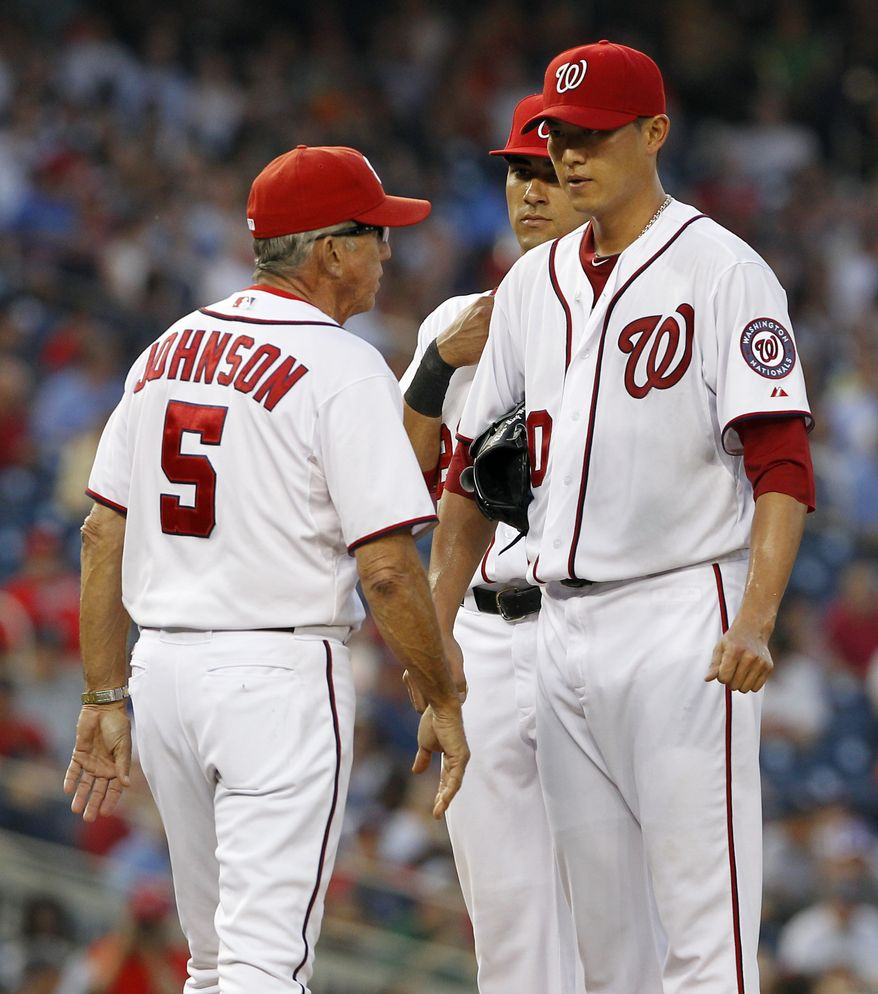Washington Nationals manager Davey Johnson comes to the pitcher's mound to pull starting pitcher Chien-Ming Wang during the fourth inning against the Tampa Bay Rays at Nationals Park on Tuesday, June 19, 2012 in Washington. The Rays won 5-4. (AP Photo/Alex Brandon)