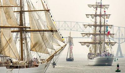 The Pride of Baltimore II, second from right, leads the Cuauhtémoc, a tall ship from Mexico, right, and the Cisne Branco, a tall ship from Brazil, left, out of Baltimore Harbor after celebrating the Bicentennial of the War of 1812 and the writing of the Star-Spangled Banner as part of a week long international tall ship and naval vessel parade called the Star-Spangled Sailabration, Baltimore, Md., Tuesday, June 19, 2012. (Andrew Harnik/The Washington Times)