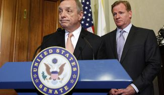 Democratic Whip Sen. Dick Durbin, D-Ill., left, and NFL Commissioner Roger Goodell speak during a media availability after their meeting to discuss bounty programs, on Capitol Hill on Wednesday, June 20, 2012 in Washington. (AP Photo/Alex Brandon)