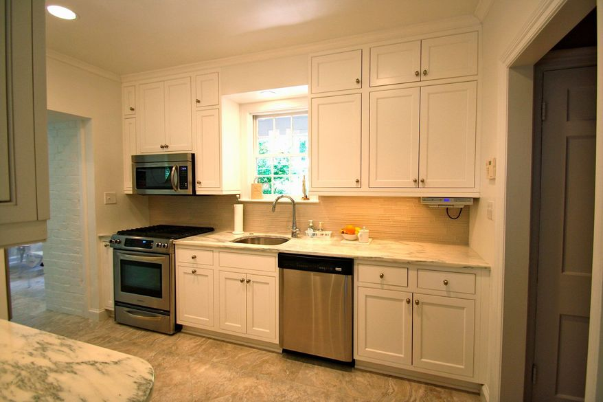 Courtesy of Case Design/Remodeling Using a space-saving microwave and installing cabinets that extend to the ceiling are ways to find extra space in a small kitchen.