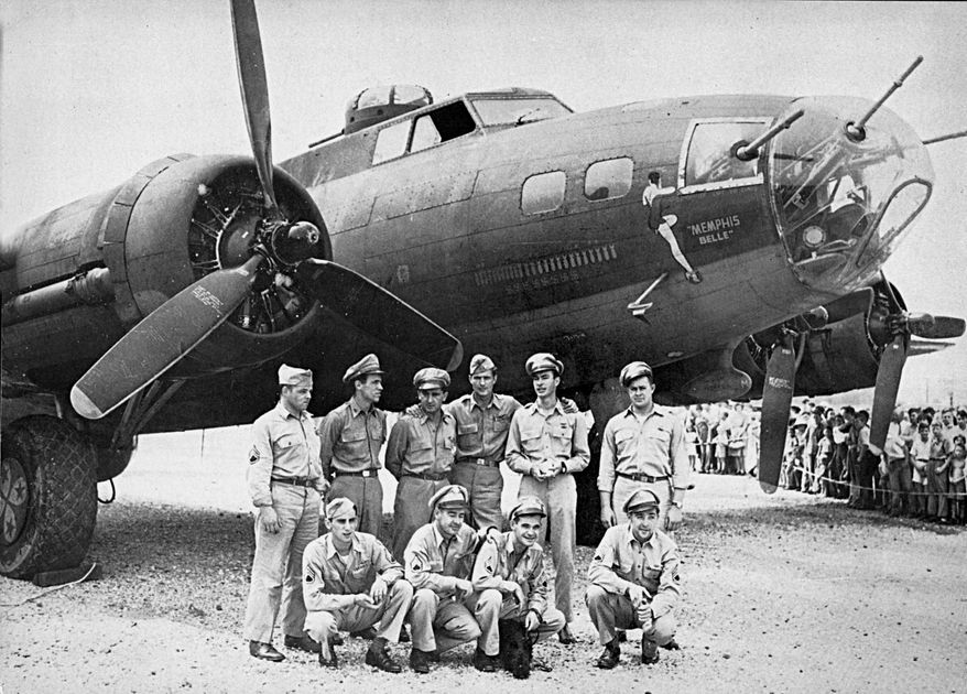 ** FILE ** This 1943 file photo shows the crew of the Memphis Belle, a Flying Fortress B-17F, poses in front of their plane in Asheville, N.C. (Associated Press)