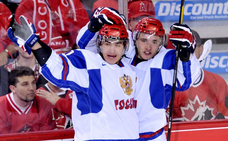 Russian Nail Yakupov (left), one of the top prospects in this year's NHL draft, relied on a friend to learn English when he came to North America to further his development. Capitals prospect Stan Galiev (below) was 16 when he left Russia. He's 20 now, with two Memorial Cup tournaments under his belt. (Associated Pr