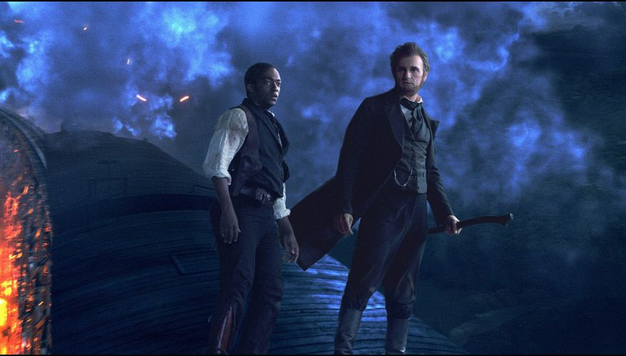 """Benjamin Walker stars as the ax-wielding title character in """"Abraham Lincoln: Vampire Hunter"""" while Anthony Mackie plays Lincoln's sidekick, William H. Johnson. (20th Century Fox via Associated Press)"""