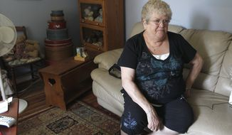 Karen Klein, 68, of Greece, N.Y., endured verbal abuse from middle school students recently as a school bus monitor. A video posted to YouTube became a sensation, prompting sympathy and at least $275,000 in donations for a vacation. (Associated Press)