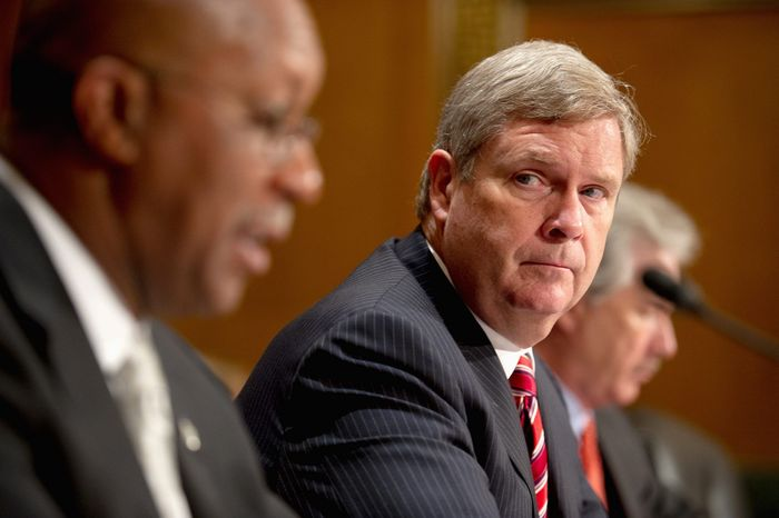 Agriculture Secretary Tom Vilsack listens to U.S. Trade Representative Ronald Kirk (left) during a Senate Finance Committee hearing Thursday on Russia joining the World Trade Organization and the administration's views on the implications for the United States. (Andrew Harnik/The Washington Times)