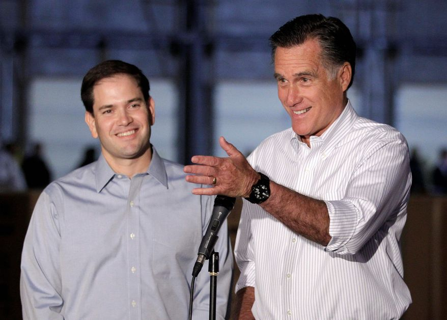 Republican presidential candidate Mitt Romney (right), campaigning with Sen. Marco Rubio of Florida, talks to reporters in Aston, Pa., in April 2012. (Associated Press) ** FILE **
