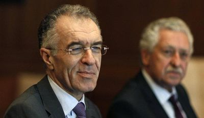 Prominent banker Vassilis Rapanos (left) and Fotis Kouvelis, leader of the Democratic Left party, attend a meeting of the Greek government coalition in Athens on Thursday, June 21, 2012. (AP Photo/Kostas Tsironis)