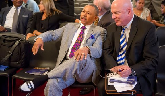 Ralph Johnson of the band Earth, Wind, and Fire, left, speaks to Thomas P. McDevitt, President of the Washington Times Newspaper, right, the Master of Ceremonies for the Congressional Award Gold Medal awards ceremony in the Cannon House Office Building on Capitol Hill, Washington, D.C., Wednesday, June 20, 2012. The 276 youth honored this year in the annual award ceremony for completing 400 hours of Voluntary Public Service activities, 200 hours each of Personal Development and Physical Fitness activities, as well as an Expedition and Exploration activity were greeted by members of congress as well as Verdine White and Ralph Johnson, two members of Earth, Wind, and Fire. (Andrew Harnik/The Washington Times)