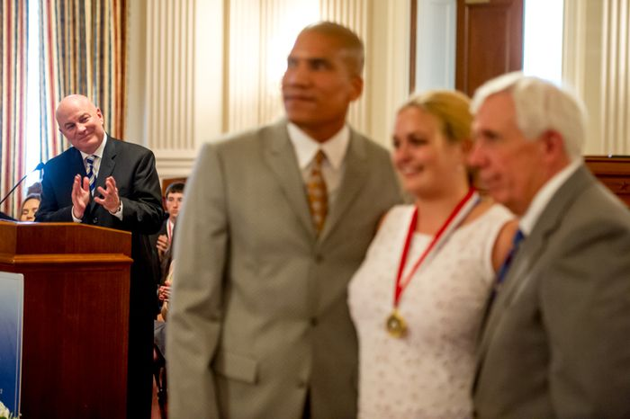 Thomas P. McDevitt, President of the Washington Times Newspaper, left, acts as the Master of Ceremonies as youth are awarded the Congressional Award Gold Medal during an award ceremony in the Cannon House Office Building on Capitol Hill, Washington, D.C., Wednesday, June 20, 2012. The 276 youth honored this year in the annual award ceremony for completing 400 hours of Voluntary Public Service activities, 200 hours each of Personal Development and Physical Fitness activities, as well as an Expedition and Exploration activity were greeted by members of congress as well as Verdine White and Ralph Johnson, two members of Earth, Wind, and Fire. (Andrew Harnik/The Washington Times)