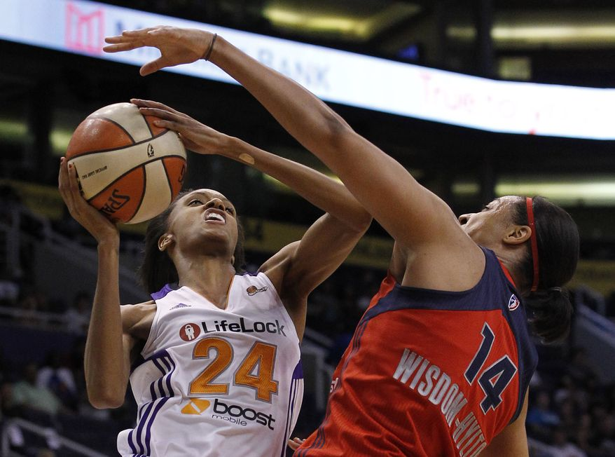 Phoenix Mercury's DeWanna Bonner (24) gets fouled by Washington Mystics' Lindsay Wisdom-Hylton (14) during the third quarter Wednesday, June 20, 2012, in Phoenix. The Mercury defeated the Mystics 79-77.(AP Photo/Ross D. Franklin)