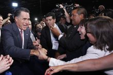Republican presidential candidate and former Massachusetts Gov. Mitt Romney greets attendees June 21, 2012, at the NALEO (National Association of Latino Elected and Appointed Officials) conference in Lake Buena Vista, Fla. (Associated Press)
