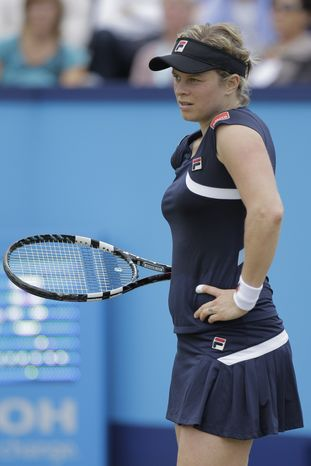 Kim Clijsters, defeated Francesca Schiavone in two sets, 6-3, 7-6, but announced her withdrawal from the Unicef Open on Friday because of a strained stomach muscle. (AP Photo/Peter Dejong)