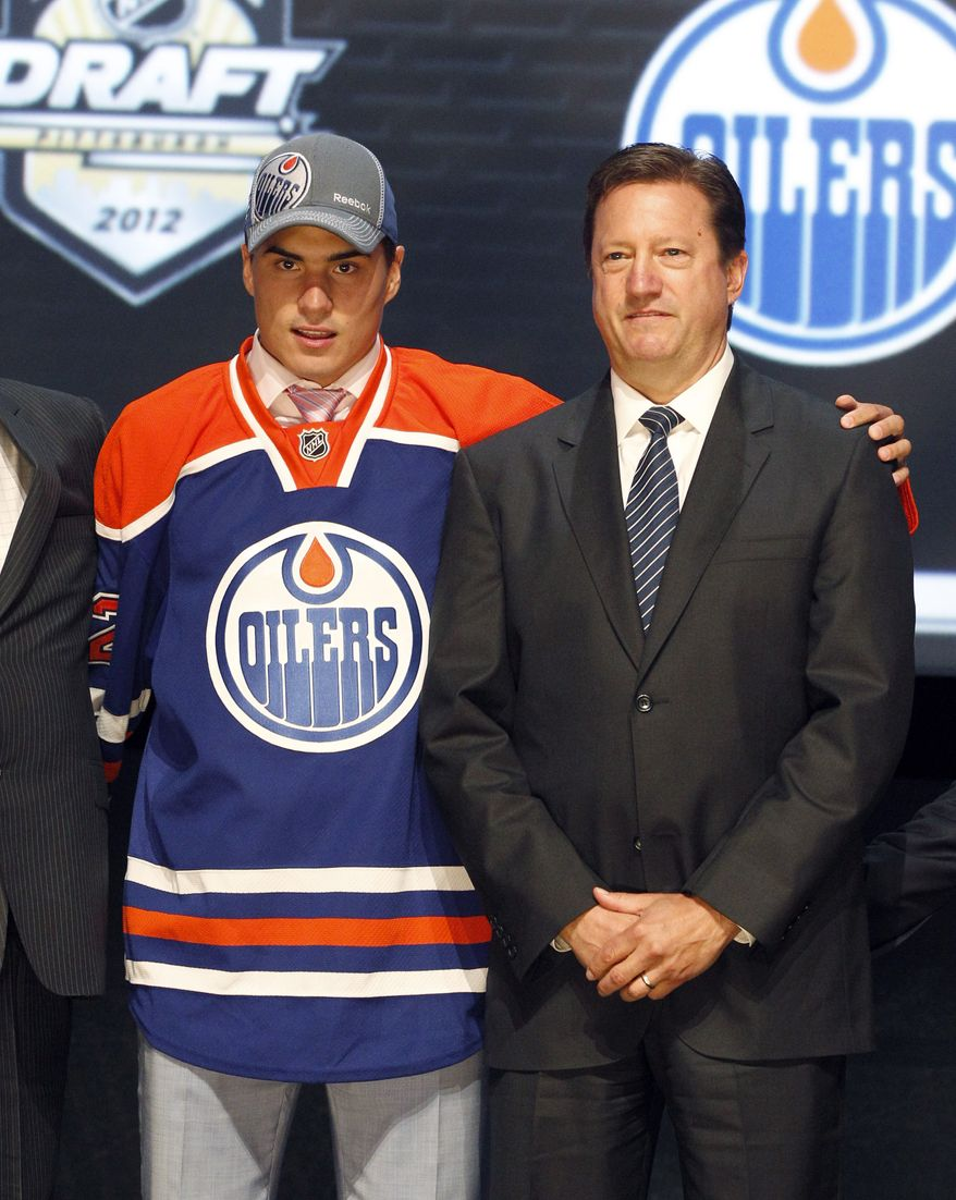 Nail Yakupov, left, a winger from Russia who was chosen first overall in the NHL draft by the Edmonton Oilers, stands with Oilers general manager Steve Tambellini on Friday, June 22, 2012, in Pittsburgh. (AP Photo/Keith Srakocic)